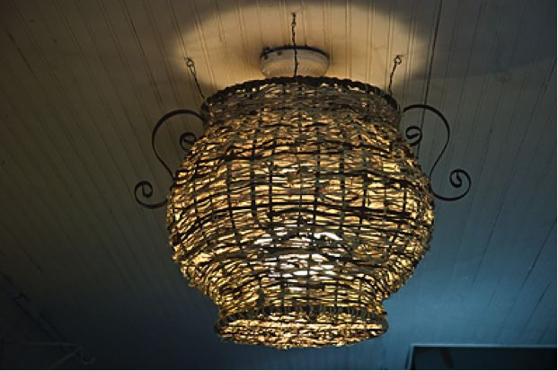 Artisan Nancy Basket creates sculptures out of dried kudzu vines, including this lampshade. [Courtesy Nancy Basket]