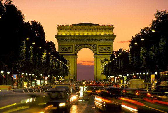 The Arc de Triomphe, just one of Paris' iconic structures, as viewed from Le Champs-Elysees, arguably the most famous shopping street in the world.