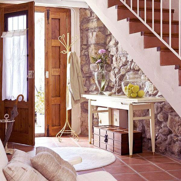 Love this entry with stone and under stair storage... rustic barn style with perfect wooden accents: