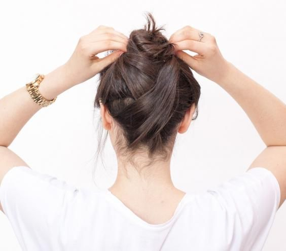 Easy Criss-Cross Topknot: This simple style takes the standard high bun from messy to fashionable. Just a few easy-to-master steps and a couple of bobby pins add a little something special, so you'll feel polished without the usual fuss and rush.
