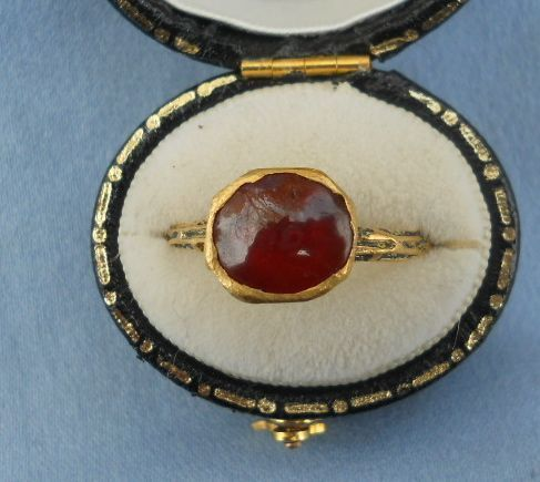 Tudor Era Ring circa 1550.  It is a cabochon garnet ring, 18 K with quite a few traces of the black enameling still surviving.  It all appears to be original, and in excellent condition.  I can't afford to buy it but I'd love to have it!