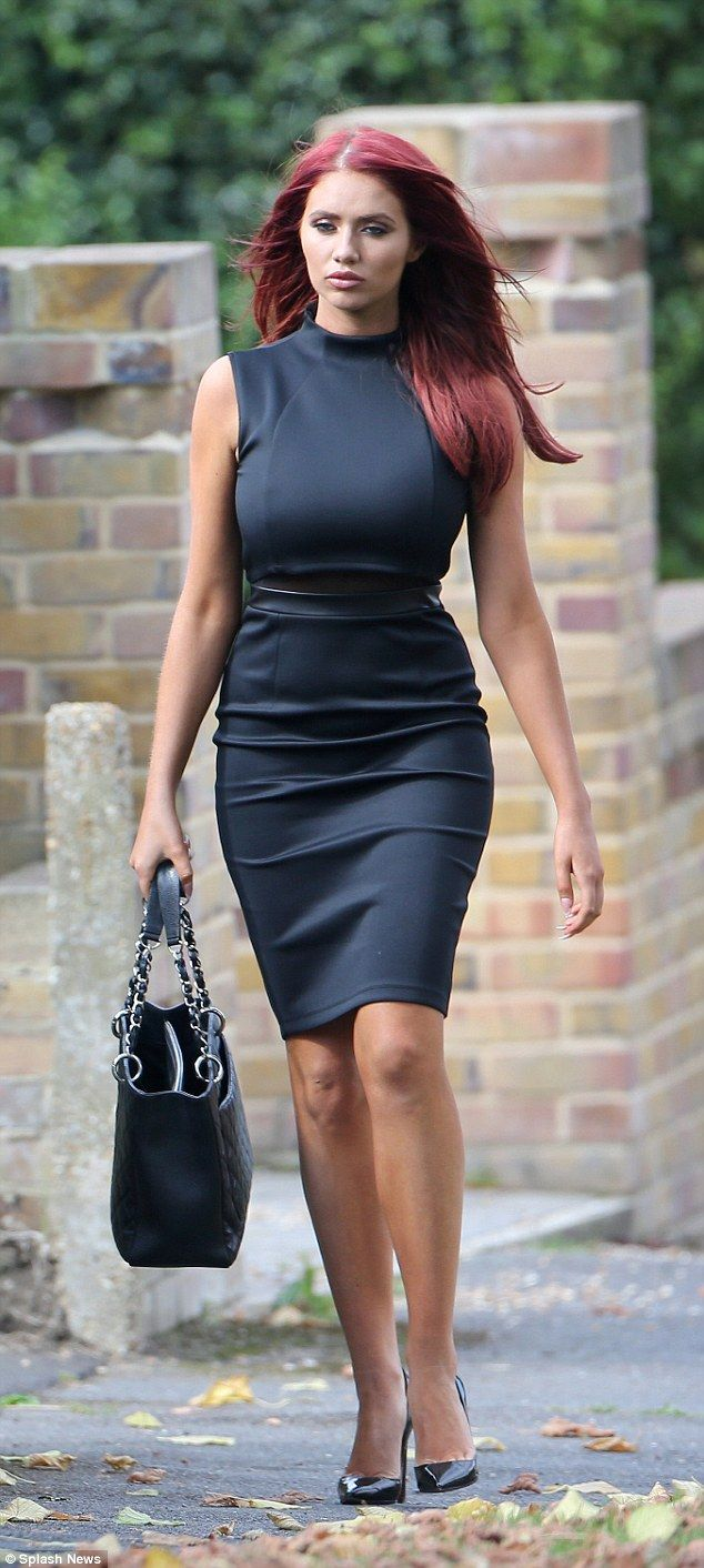 Looking good: T he boutique owner looked chic as she strolled through the streets in a sophisticated black dress which featured a surprising high neck line