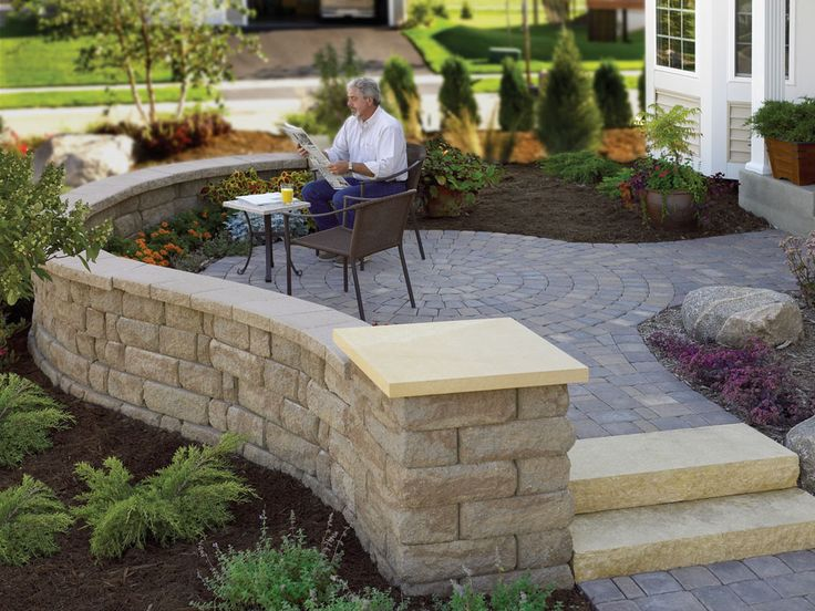 A Raised Patio Featuring The Highland Stone® Wall System