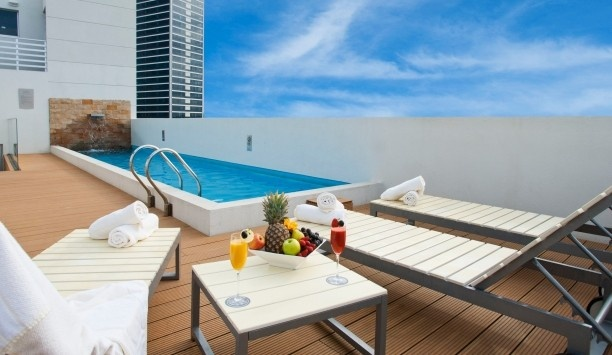 After Hotel Montevideo: The rooftop pool and lounge area has views across the Montevideo skyline and river.