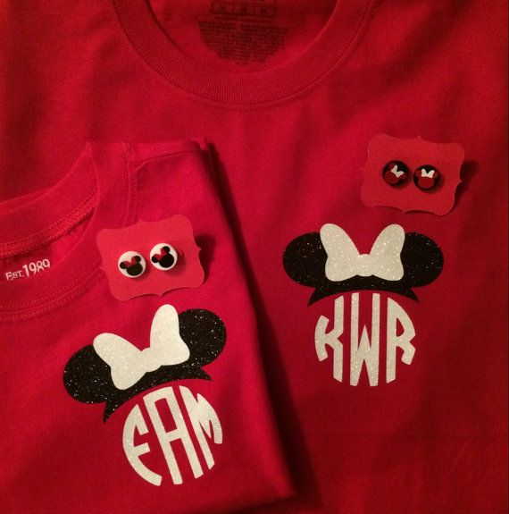 Great choice for your family vacation!  This is a cotton t-shirt with a mouse ear monogram with a bow. Colors available are white or red shirts
