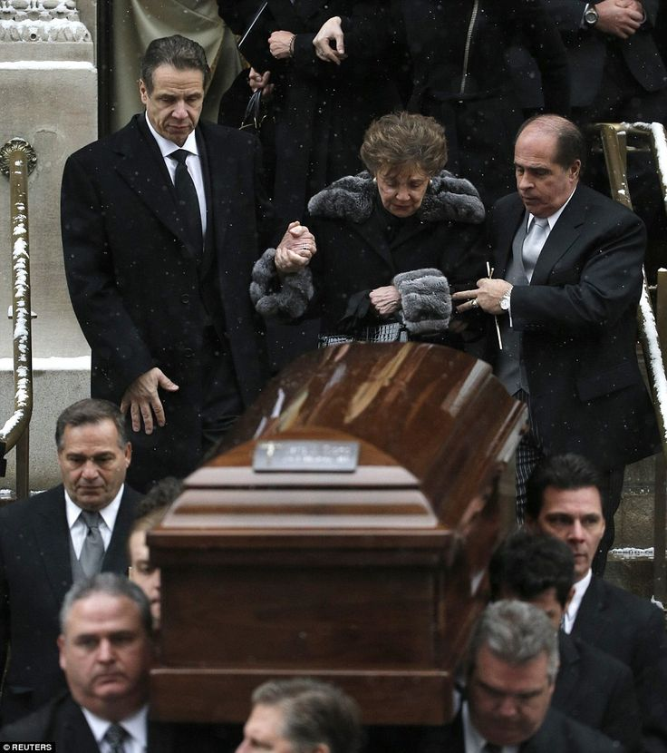 Saying goodbye: Current Governor Andrew Cuomo and his mother Matilda Cuomo watch as the casket of former NY Governor Mario Cuomo is carried from the church following Andrew Cuomo's moving eulogy to his father.