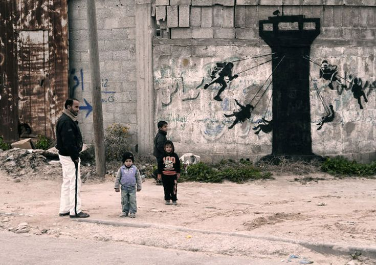 Modern art that makes sense: Banksy Sneaks into Gaza to Paint His Most Controversial Pieces of Street Art