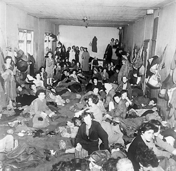 Women and children, former inmates of Bergen-Belsen ...