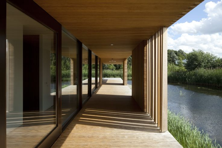 The porch of this watervilla gives shade in the summer and shelter in wintertime. Design by: @70farchitecture   #architecture #contemporaryarchitecture  #architect #architectuur #architectenbureau #modern #modernarchitecture #minimalistic #lines #archdaily #dutcharchitecture #functionaldesign #wood #hout #building #villa #urban #home #house #huis #modernvilla #lelystad #porch #water #summer #shelter #shade