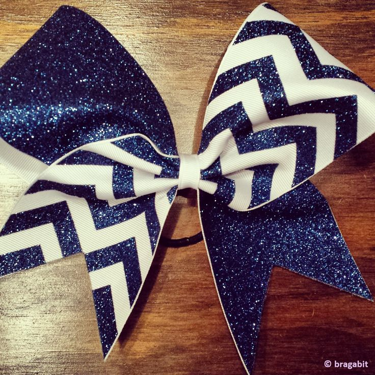 Navy blue glitter and white ribbon chevron cheer bow.