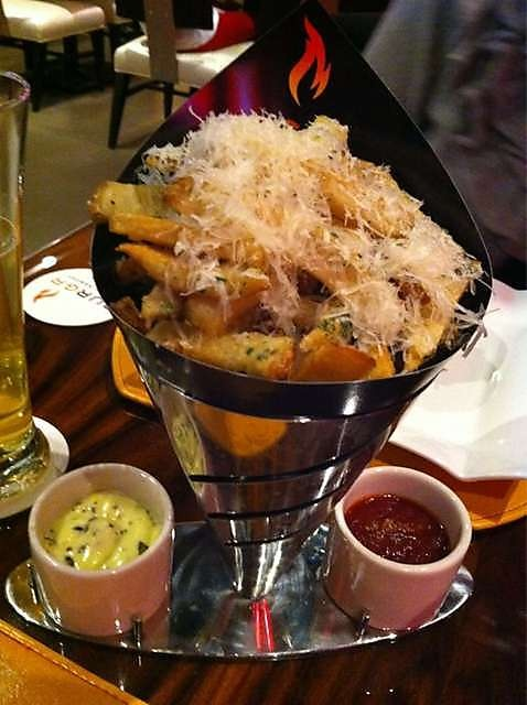 Parmesan Truffle Fries @ Gordon Ramsey's Burgr located in Planet Hollywood, Vegas.  Fries will never taste the same AMAZING!!!!!!