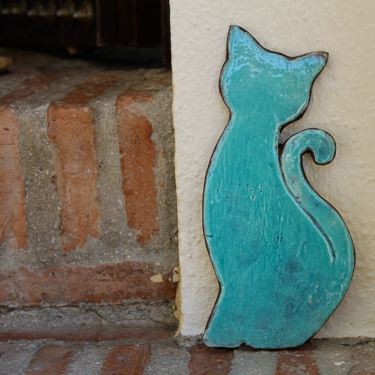 cat silhouette wall art - wall hanging - cat ornament - turquoise ceramic cat - home decor - garden decor. €15,00, via Etsy.