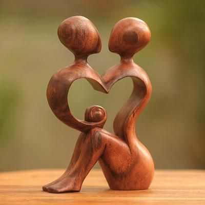 Wood sculpture, 'A Heart Shared by Two'. Shop from #UNICEFMarket and help  #UNICEF save the lives of children around the world.