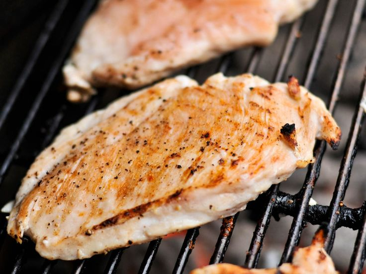 Grilled skinless chicken breasts are all too often more like pieces of cardboard than food you'd actually want to eat. With a little know-how, however, you no longer have to stand for this injustice. The key to juicy grilled chicken breasts is to brine them first, then cook them over a two-zone fire and pull them off when they're perfectly done.