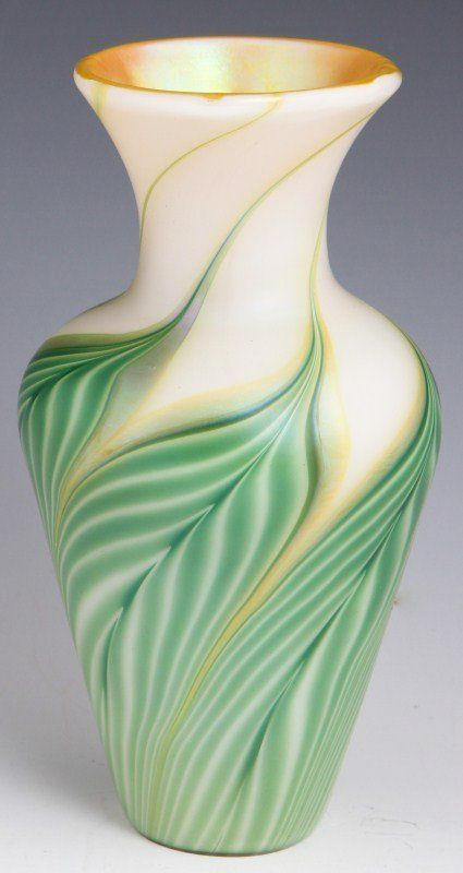 Lundberg Art Glass Vase. A small opaque cream vase with green pulled feather design giving the impression of leaves