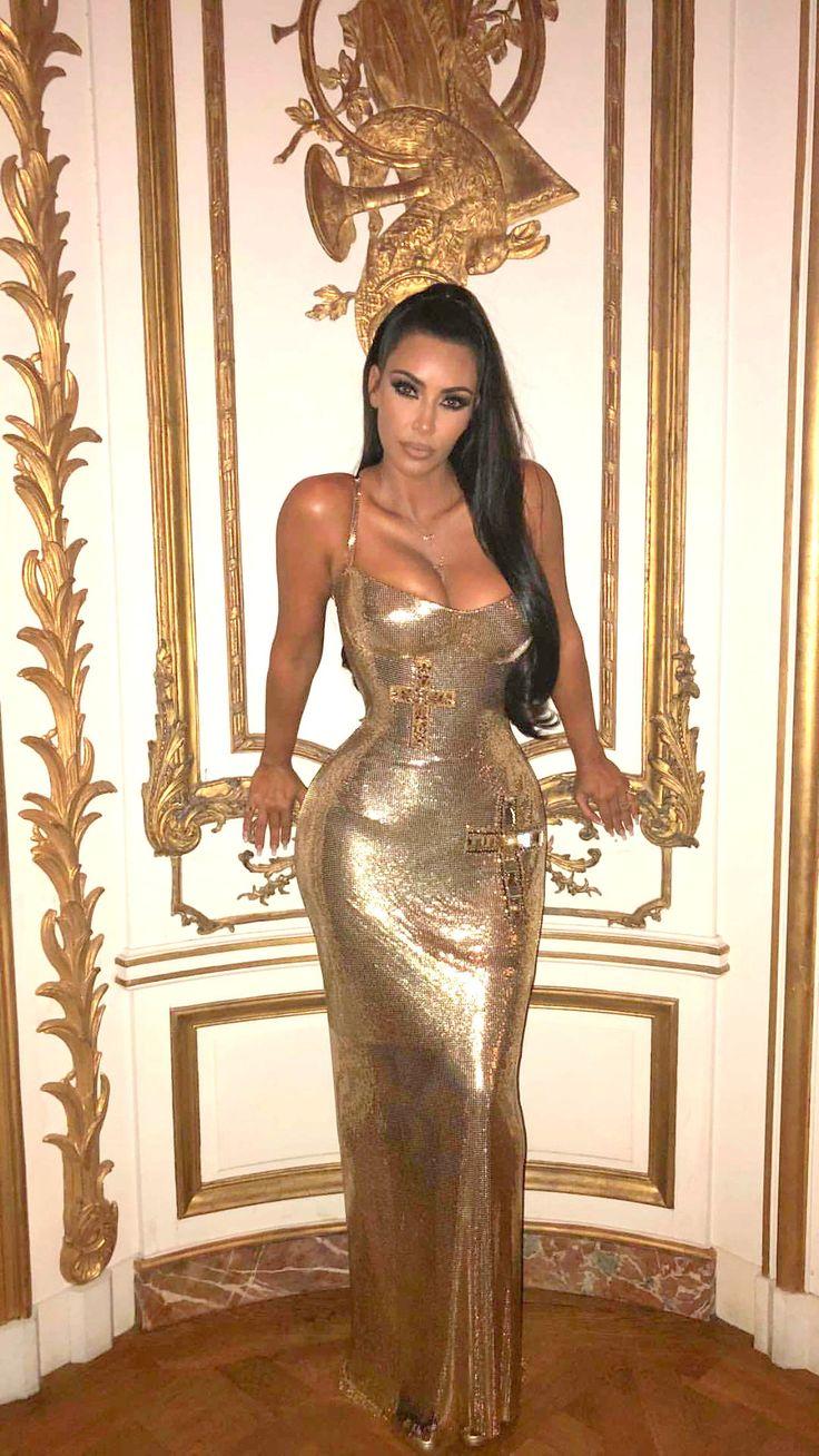 Kim Kardashian wearing a gold dress at the met gala # ...