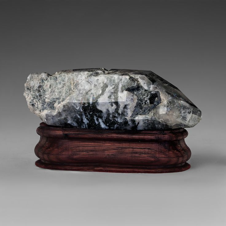 Landscape quartz crystal with inclusions of chlorite and sericite.-mineral`s collection