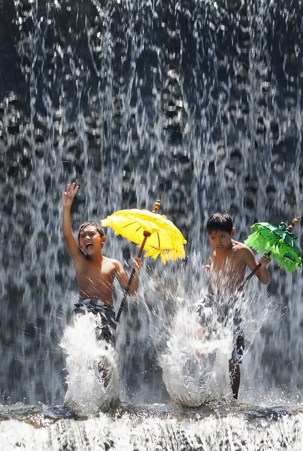 Must do once! Dancing with an umbrella in a waterfall!