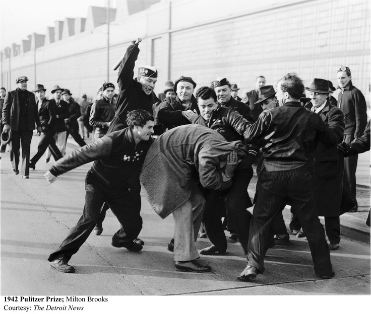 """ Ford Strikers Riot "" was taken during the 1941 workers' strike at a Ford manufacturing plant.  The picture shows a worker beating a strikebreaker, who is trying to protect himself by pulling his coat over his head and face.Photo by Milton Brooks"