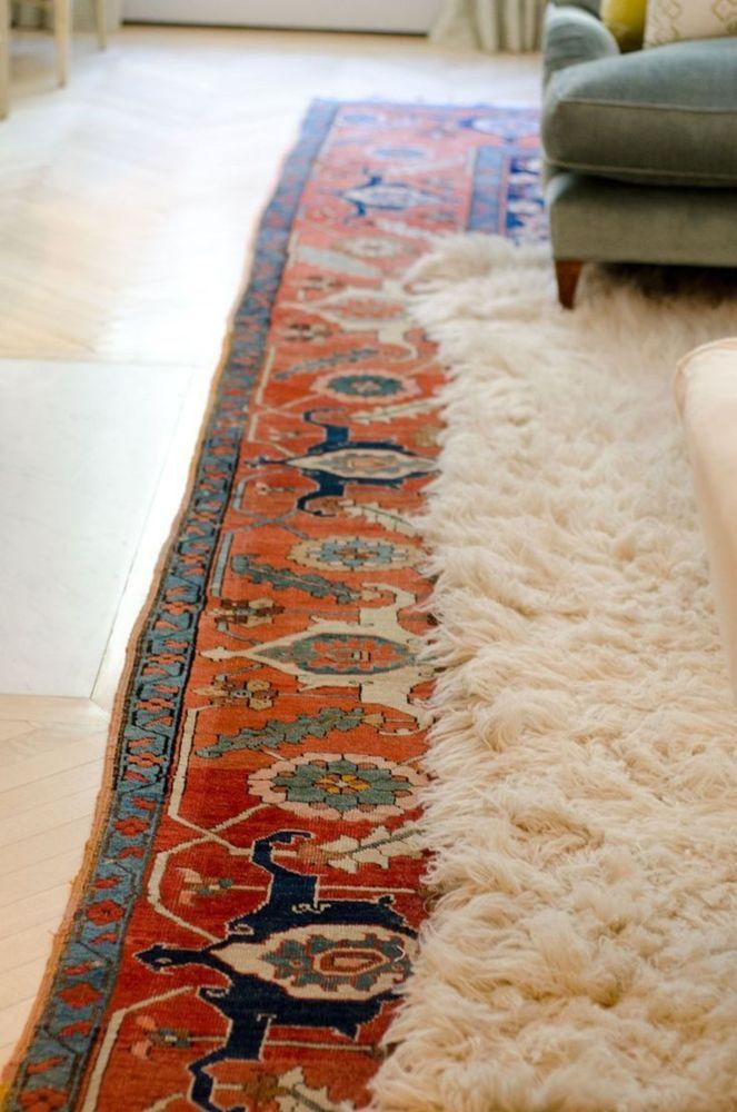 Flokati layered over Persian or Moroccan rug...