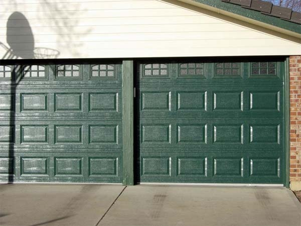 Steel garage door replacement in arvada littleton and for Garage roofing options