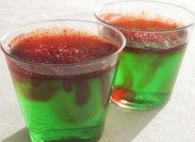 Christmas Tree Jello Shots...2 cups  Boiling Water, 1 Large Package, 6 oz. Lime Jello, 1 cup Cold Water, 1 cup Vodka, Splash of Bourbon, Red Colored Sugar...Pour boiling water over Jello and whisk until combined. Slowly whisk in cold water, vodka, and a splash of bourbon. Pour mixture into cups and refrigerate until set. Sprinkle with red sugar before serving.