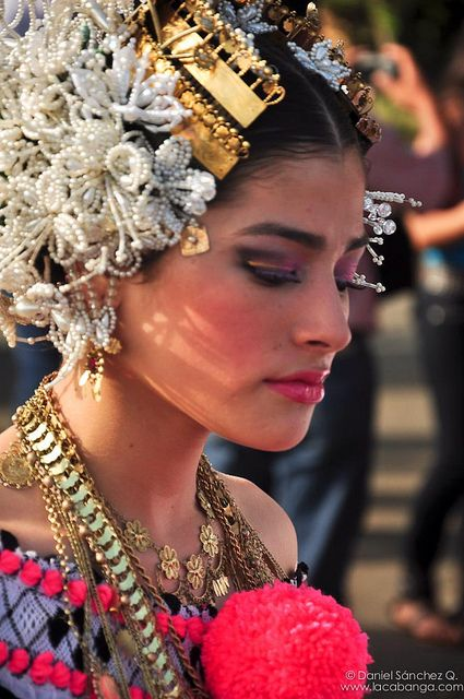 Pollera traditional costume, Panama. The pearl-like hair decorations are called tembliques.