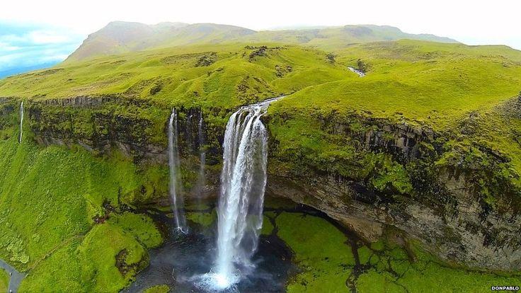 Drone photo of a waterfall in Seljalandsfoss, Iceland.