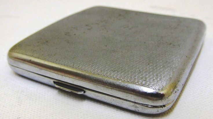 Chrome plated, cigarette case with flip lid.  Belonged to Flight Lieutenant Stanley Bruce de Vere.  From the collection of the Air Force Museum of New Zealand.
