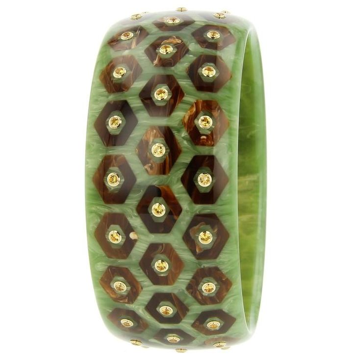 Mark Davis Bakelite Yellow Sapphire Yellow Gold Bangle   From a unique collection of vintage bangles at https://www.1stdibs.com/jewelry/bracelets/bangles/