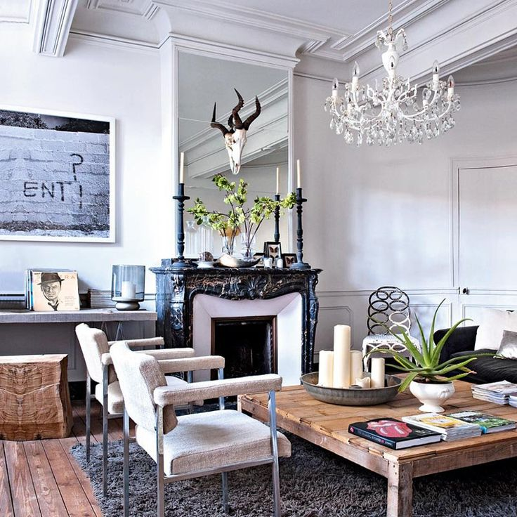 style mix in the living room, vintage marble fireplace, modern chairs & table