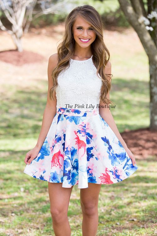 Your dreams have finally come true! We have the most amazing floral and lace combo dress! This features a white lace top with a halter style, zipper in the back, and a multicolor floral print on the skirt! Don't hesitate to get yours, because it's sure to be an instant sellout!