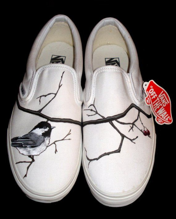 Custom designed Vans on Etsy by TKDeal, a student of the Art Institute and living in Portland. Some of the designs are a bit much, but overall, I am totally digging this simple bird design that ties the tree branches through each shoe. $97