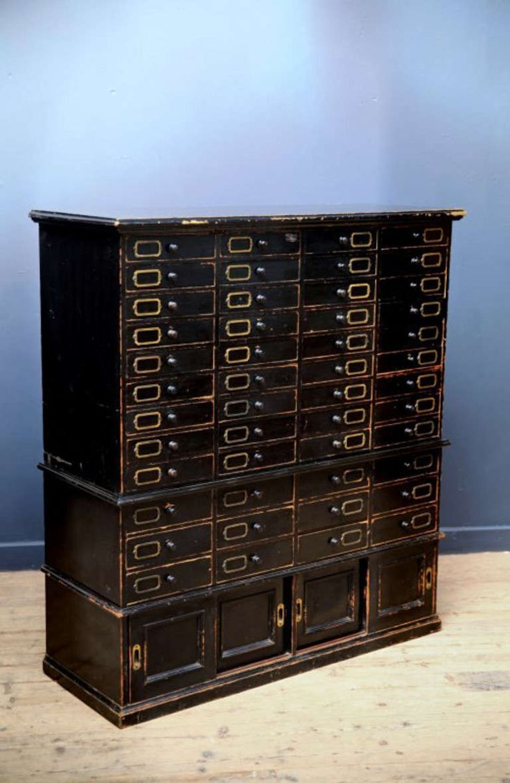 An ebonized cabinet, probably an early shop or office fitting.   Of unique and excellent construction, comprising bank of drawers above two compartments with sliding doors.   Manufactures stencil mark to the back for Frederick Sage & Company of London   English, after 1860