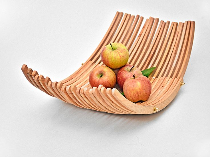Beautiful beautiful beautiful. A bowl made from old wooden hangers.