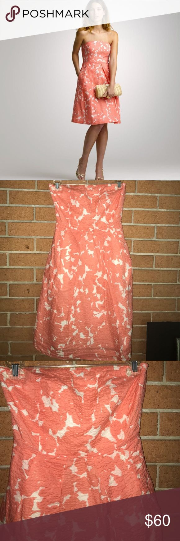 """🌷J. CREW🌷STRAPLESS EMBOSSED DRESS🌷 This is a beautiful strapless A-line dress from J.Crew well-made as we know this brand is back hidden zipper with Eye and hook closure. Rubber backing to help keep up the dress also comes with built in bra strap for a better fit. 100% cotton. Coral and white. Measurements taken flat bust 14"""" waist 12 1/2"""" hips free length 29"""" perfect for any location including weddings!! J. Crew Dresses Strapless"""