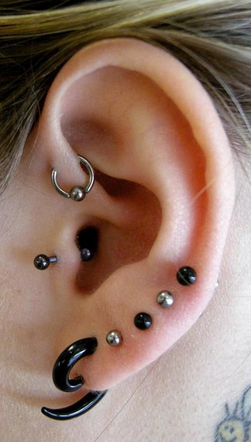 Mixed Lobe & Upper Ear Piercings with black & Steel body jewellery. With Tragus Piercing and Stretching Spiral. Buy yours at www.karmase7en.com