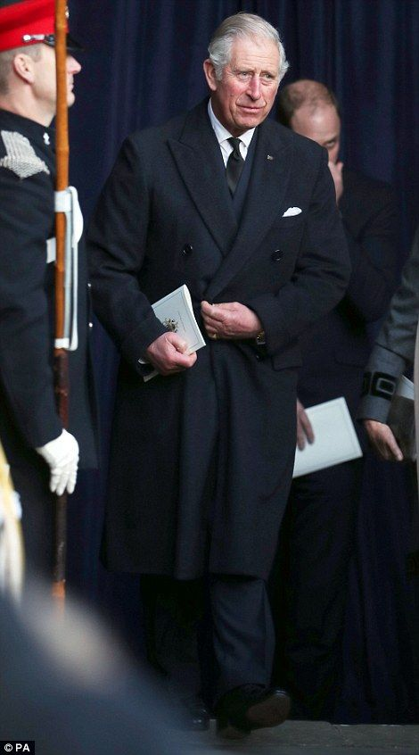 Prince Charles carries an order of service as he leaves the cathedral...