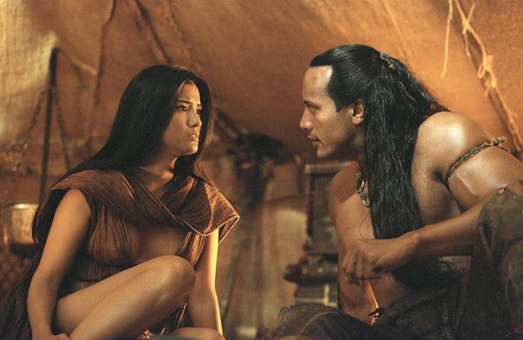 Mathayus (the Rock) and Cassandra (Kelly Hu) are being pursued by Memnons' army in The Scorpion King. Description from sptimes.com. I searched for this on bing.com/images