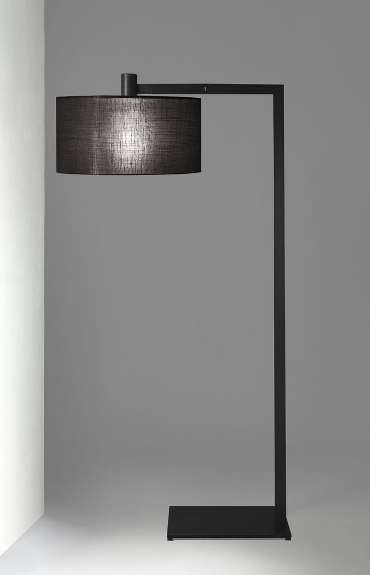 floor lamp with structure in chrome burnished metal brass or painted metal shade in white or black fabric total height shade size diam x 4 to 18 black fabric lighting