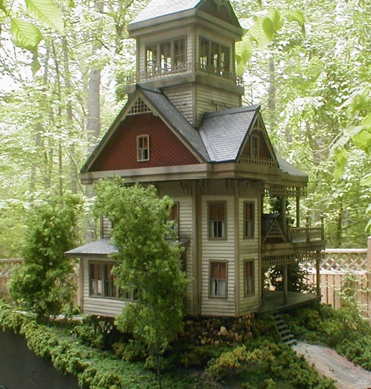 Classic Appalachian Gothic three story house with oversized cupola and stone foundation.
