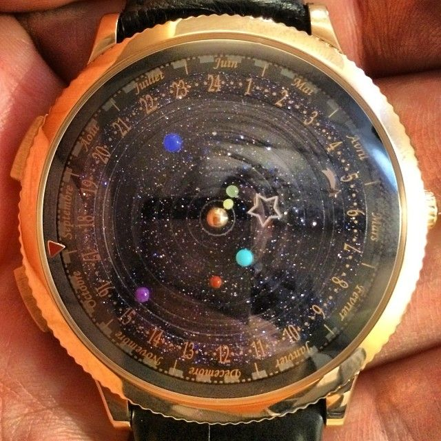 asapscience:  The Midnight Planétarium watch not only tells time, but follows the orbit of our solar system's planets.