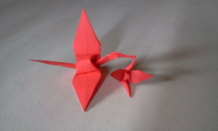 origami bird , you can watch this video in you tube with link http://youtu.be/LECRIvIEhlg