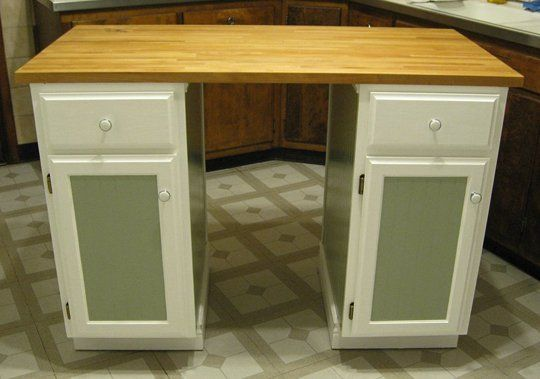 A super easy kitchen island made from standard kitchen cabinets with a little bead board and molding to dress it up.