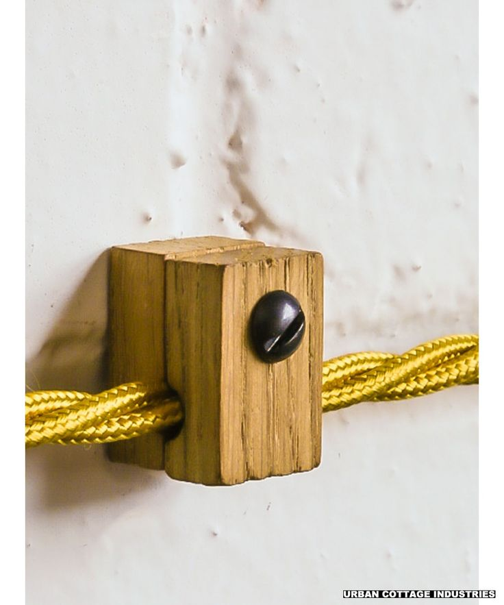 Wood Cable Holder | Single An attractive alternative to the plastic cable clip or P-clip, this wooden holder can be used to run lighting flex along a surface or suspend a pendant with a loop in the cable. The two halves of the holder are made from reclaimed oak and the internal diameter of the hole is 6mm.