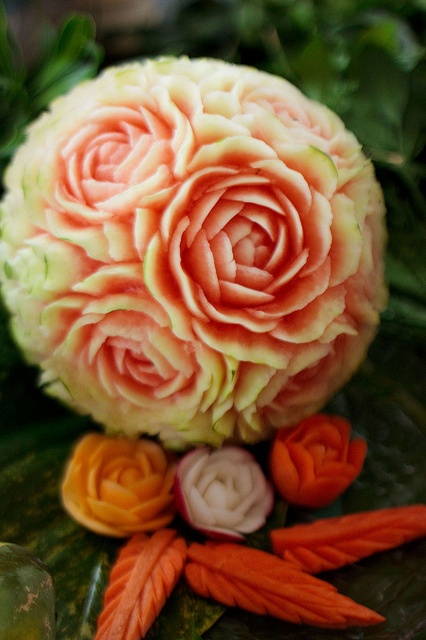 melon carving looks like it might be fun.  this is so pretty!  there are so many variations that can be done.  Flower Melon by pindo007, via Flickr
