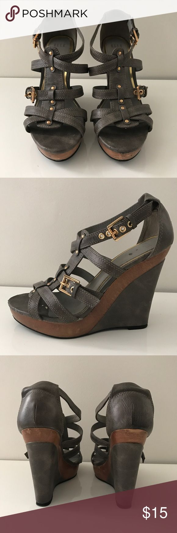 Elle gray and gold wedge sandals Elle wedge sandals. Gray with gold hardware. Bottom too edges a little worn (as seen in photo) but otherwise in good condition. Size 7.5 Elle Shoes Wedges