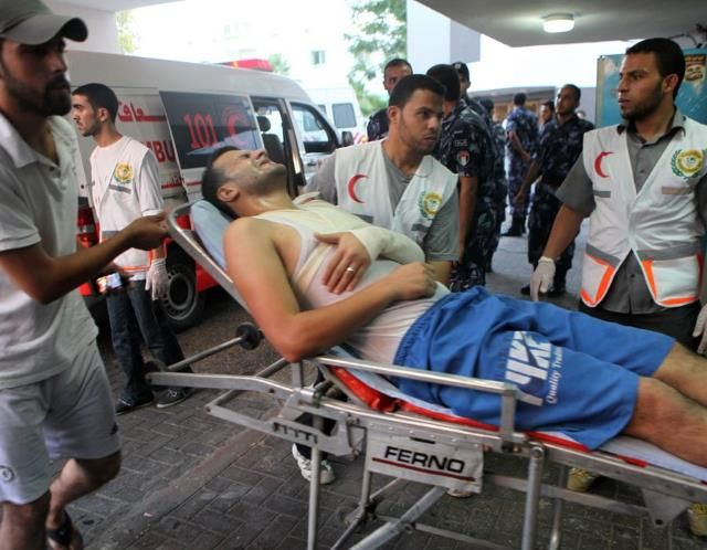 Israel pounds Gaza Strip (© GAZA CITY, GAZA - JULY 8: Wounded Palestinians are taken to hospitals after Israel airstrikes targeted different points of Gaza city, on July 8,2014. (Photo by Ezz Zanoun/Anadolu Agency/Getty Images))