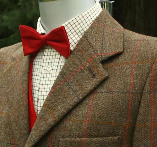 Tweed, tattersall shirt, red waistcoat and bow tie (would be better if it was self tie)