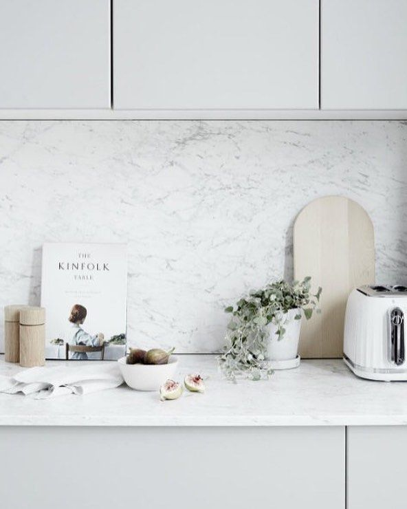 The beauty of neutrals. Loving this grey and white kitchen featured in this month's @reallivingmag stylist: @corina_koch_stylist photo: @ksoljo